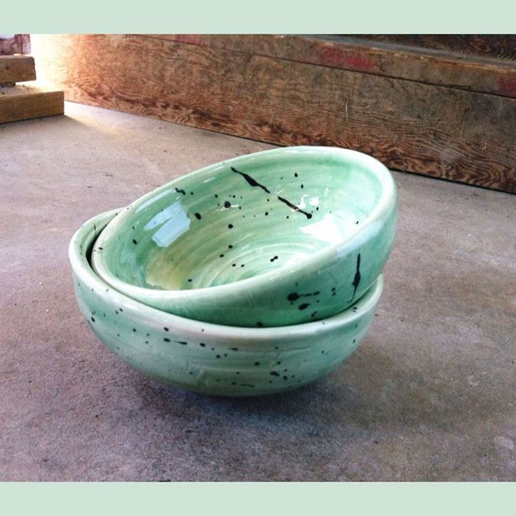 large mixingbowls, glazed true celadon with satin black splatter