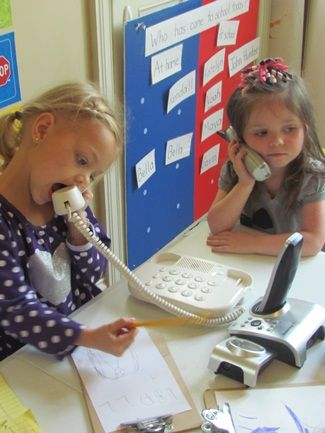 preschoolers working on their communication skills with telephones...love for a pretend and learn center!