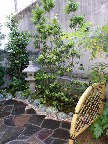 Stone edging around a flagstone patio in a Japanese garden.