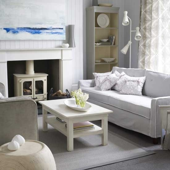 Rustic white living room with cool stove mantle