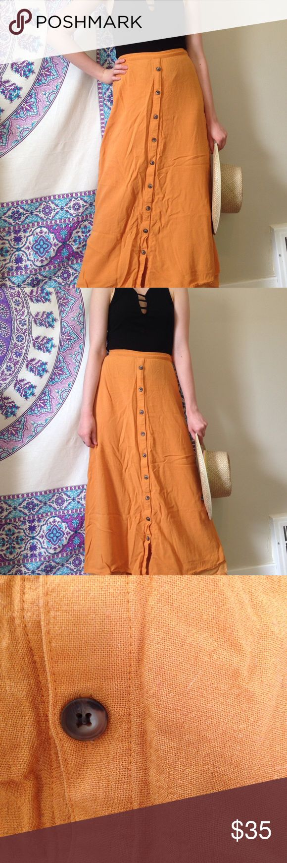 Burnt Orange Maxi Skirt Perfect condition just needs an ironing. Button detailing down the front. Liner underneath the skirt to ensure no seeing through the material. Feel free to make an offer and ask any questions 🛍💕✨ Ellen Tracy Skirts Maxi