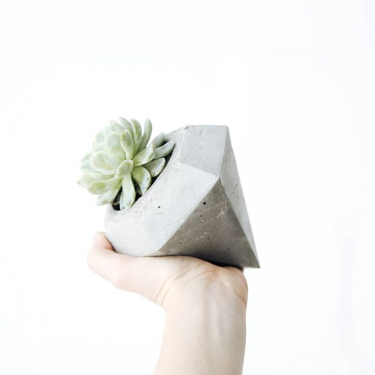 This is one of our favourites, our diamond cement pot plant holder.