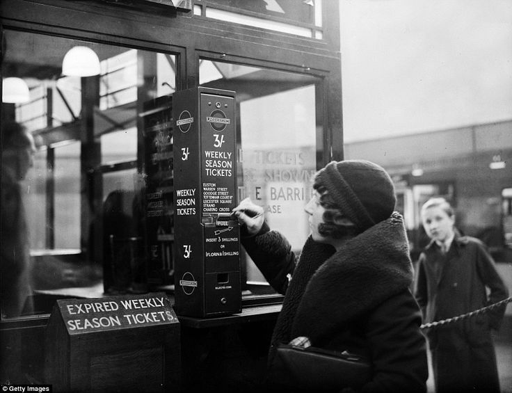 A traveller buys a London Underground season ticket from a vending machine at Highgate Station in London