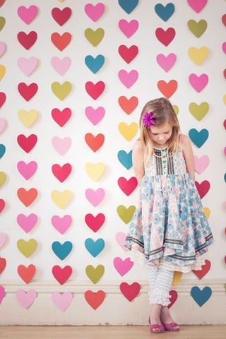 Valentine photo shoot - heart backdrop idea - a punch, some colorful cardstock and a sewing machine - DONE!