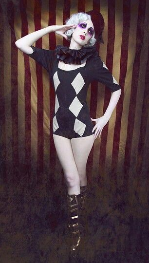 Circus theme- I feel like it'd be easy to paint or cut out fabric diamonds and add them to a plain dress like this.