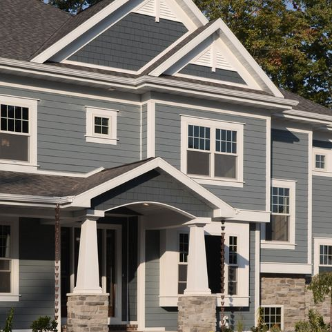 this home has a design and color combo hardieplank siding on the lower sections in