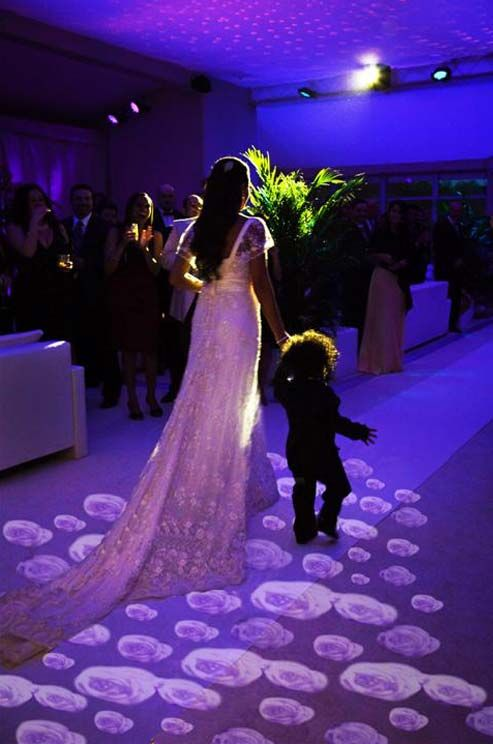 These motion sensitive flowers on the aisle bloom as the bride walks over them. This small lighting detail makes a huge impact!