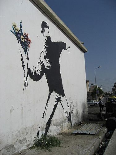A documentary directed by Banksy has arrived in North American theatres. Famous despite the fact no one knows his identity, the project began when the British street artist turned his camera on a f…