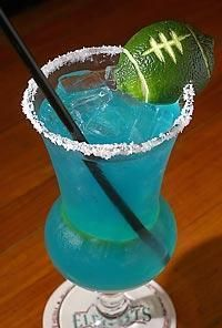 12th Man Margarita's - Seahawks special photo 1 3/4 oz tequilla ; 3/4 oz blue curacao ; sweet and sour ; 2 lime halves