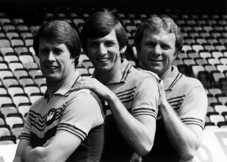 A portrait of three ex-England players. From left: Geoff Hurst, Martin Peters and Bobby Moore
