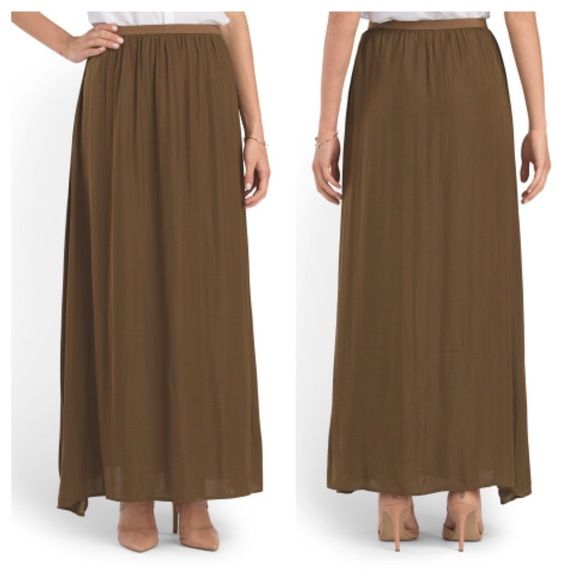 "Host Pick NWT bronze olive maxi skirt Brand new with tags and never worn. 42"" long. Elastic waist. No PP or trades. Will consider offers. Philosophy Skirts Maxi"