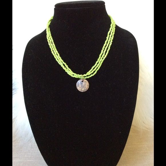 """Initial """"M"""" Stone/Glass Bead Necklace  Lime green beaded initial """"M"""" necklace purchased from local boutique. Initial carved on stone medallion with strands of glass beads. Super cute color!  Dress up or down Jewelry Necklaces"""