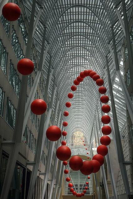Toronto, Canada: Long Wave; photograph by Timothy Neesam. Infinitely bouncing ball at Luminato, art installation by David Rokeby; at Allen Lambert Galleria, Brookfield Place