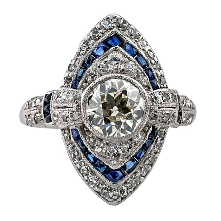 Art Deco Sapphire Diamond Ring. Finding true vintage Art Deco rings as beautiful as this one is rapidly becoming a rarity in itself, the navette-shaped design centers upon an old European-cut diamond weighing approximately 0.90 carat, approximately L - M color and VS clarity, within a triple surround of graduating smaller round diamonds and French-cut sapphires. c 1925