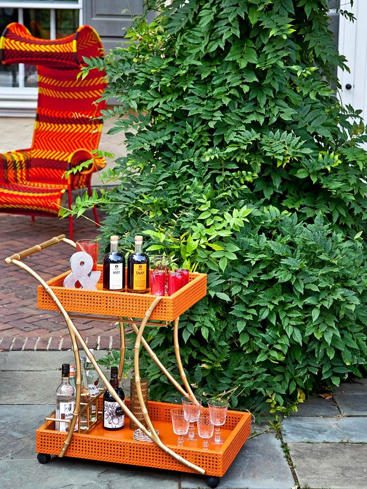 Don't tote heavy trays of drinks all over the yard! This bar cart has wheels, so serving is a snap. (You can also park it in a central location if you prefer guests help themselves.) Image by Courtney Apple, courtesy of Society Social. Styling by Styled Creative.