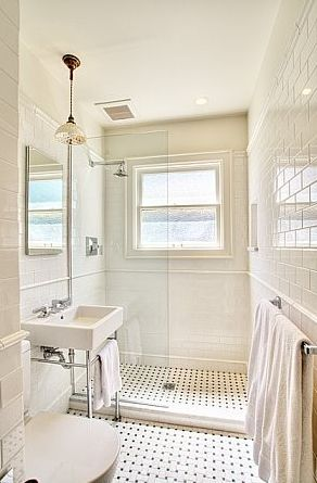 very much like what i'd like for our third-floor bathroom. definitely a dark cabinet, too, but this flooring and this feel of age.