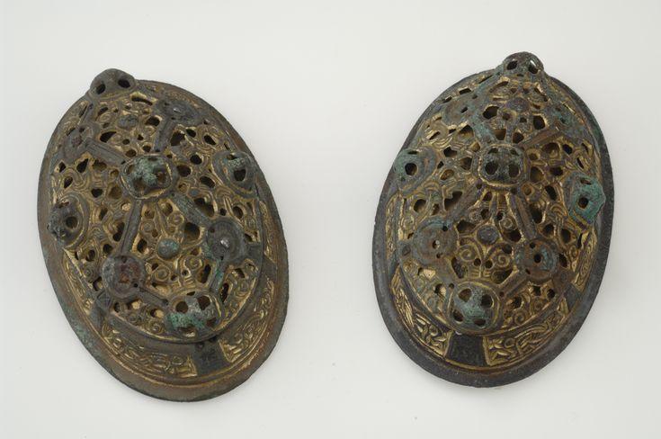 Oval brooches. Bronze, iron, textiles. The brooches are gilded. Grave find, Björkö, Adelsö, Uppland, Sweden.  SHM 34000:Bj 566  See also kulturarvsdata.se/shm/object/html/560680