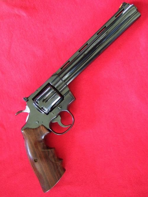 The Colt Python was first introduced in 1955 as a premier power revolver, capable of firing six powerful .357 Magnum rounds.  Additionally, Pythons boast top-quality finishes on a robust frame with a smooth trigger pull, adjustable rear sights, and a tight cylinder lock-up.  The longer 6 or 8 inch barrels offered are typically favored among handgun hunters. Pythons are widely considered to be first-class weapons by gun enthusiasts even by today's standards.