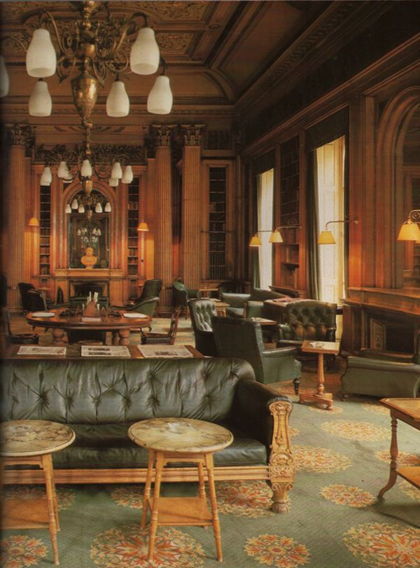 The Smoking Room at London's Reform Club; designed as a library for this 1836 institution, is replete with suites of handsome worn tufted leather upholstered furniture. The World of Interiors, November 1984; photography by John Vere Brown.