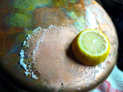 Cleaning Copper. Salt and Lemon, Also works very effectively with salt, vinagar, and a scrub pad.