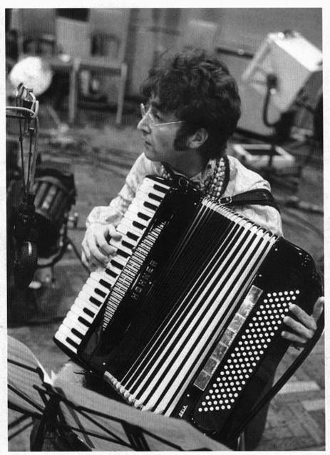 """Photo taken during rehearsals for the """"All You Need Is Love"""" satellite broadcast on June 25, 1967.According to Jack Emblow, the accordion player with the orchestra that accompanied the Beatles on the recording and during the live telecast,John borrowed the accordion to run through some parts with some of the players in the studio during a recording session.It was recorded on June 14th 1967. 1604676_716498481704968_874463371_n.jpg (463×639) from Lennon on Facebook."""