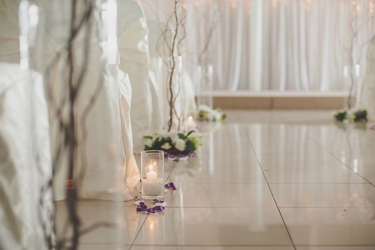 Tall branches and candles lining the aisle #WeddingDecor