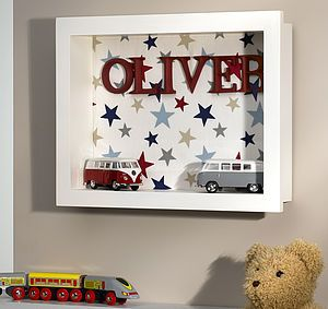 line a shadow box with scrapbook paper, stickers, or embellishments and personalize your child's room