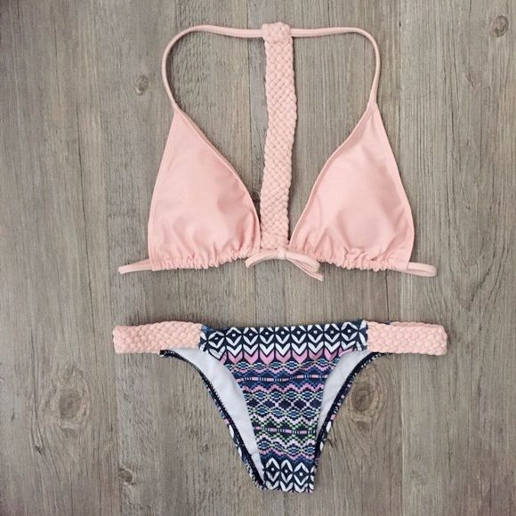 NWT The Aztec Bikini NWT Get ready for summer with this cute pink Aztec bikini! Top ties in the front and has cool braided design down the back. Same braided details are on each side of the bikini bottoms. This is sold as a set, will not sell pieces separately.   Swimsuit Style: Racerback Cheeky Bikini Cups: Yes, removable Color: Light Pink with Blue, Pink, White, Green Aztec design Material: Polyester & Spandex Design: Aztec and Braided Details Size: Large (true to size)  *This is a NWT…