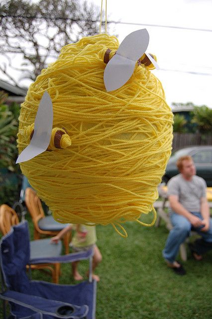 Bee Hive.  Made with yarn and looks like it is covering a balloon.