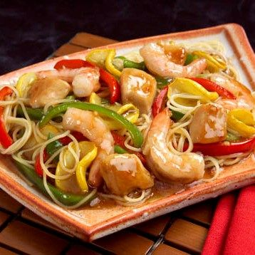 Tender chicken and shrimp tossed with seasoned colorful vegetables and angel hair pasta