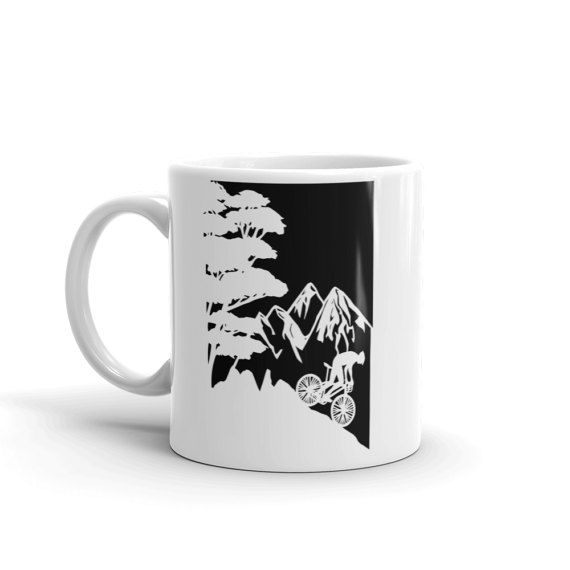 This listing is for an mug with a print of my mountain bike papercut.  The perfect gift for bike lovers and cycling enthusiasts.  - Ceramic - Dishwasher safe - Microwave safe - Available in 11 oz and 15 oz sizes - White, glossy  This sturdy white, glossy ceramic mug is an essential to your cupboard. Looking for the perfect amount of your hot beverage without refills? Search no more. This brawny version of ceramic mugs shows its true colors with quality assurance to withstand heat in the…