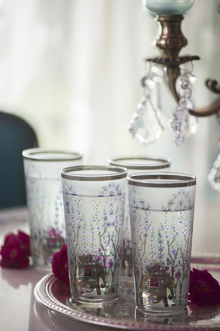 COCKTAILS & CARDS Our resplendent jewel glasses are great for serving drinks during special evening gatherings. #entertaininstyle