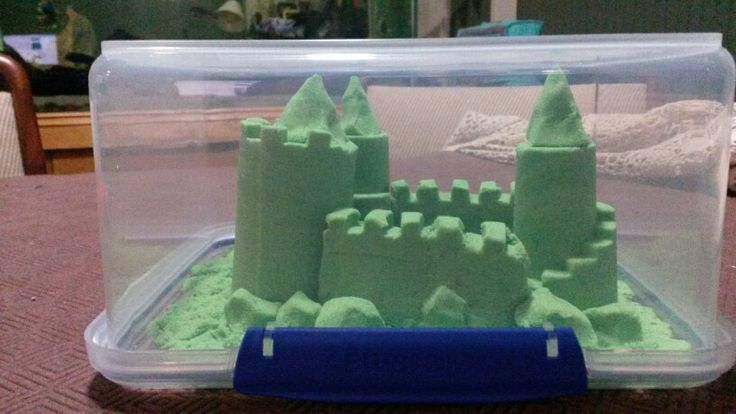 Kinetic sand model sculpted and displayed in a sistema container upside down.