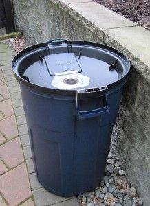 How to make a rain barrel for $18 | Greener by the Week. Spray paint the barrel to blend in with house.