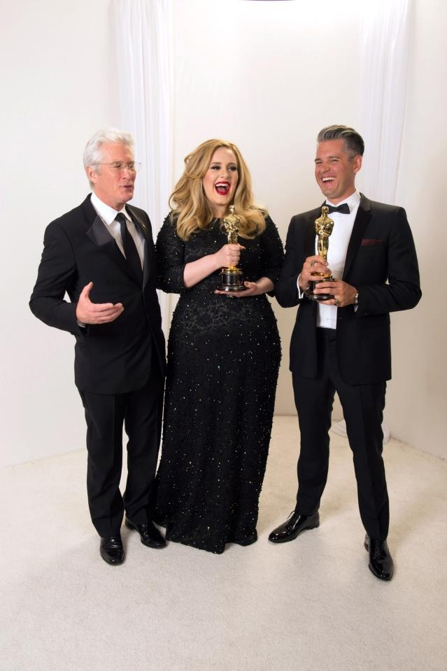 """After winning the category achievement in music written for motion pictures (Original song) for """"Skyfall"""" from """"Skyfall"""", Adele Adkins and Paul Epworth pose with Richard Gere during the live ABC Telecast of The Oscars® from the Dolby® Theatre in Hollywood, CA, Sunday, February 24, 2013. ©A.M.P.A.S"""