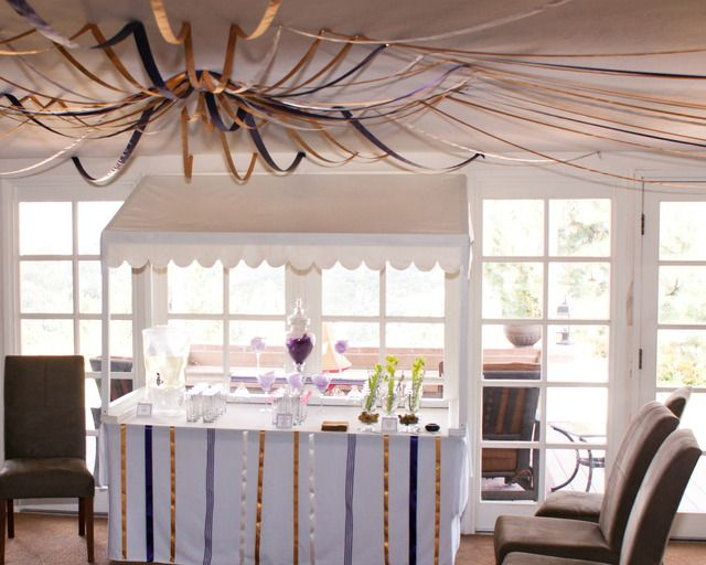 Ribbon draped ceiling for a circus bridal shower themed party
