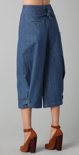 """These denim gaucho pants feature 5-pocket styling and a single-button closure. Patch side pocket. Tie at back and button-tabs at hem.  * 13"""" rise. 20"""" inseam. * 28"""" leg opening."""