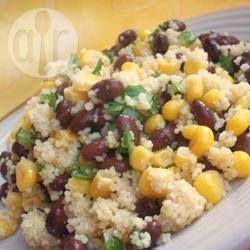 Black Bean Couscous----This is a Mediterranean version of couscous salad. It is a hearty and flavoursome dish with beans, corn and much more. Preparation: 0:15, Cook: 0:15, Serves: 4, Unrated,