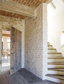 Lovely wooden floor and stairs in what seems to be a barn conversion. Exposed bricks, etc.