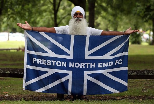 News Photo : A Preston North End fan looks on ahead of the Sky...
