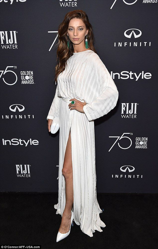 A bit of all white: Angela Sarafyan, 34, who has appeared on Westworld, put her best foot forward in a white gown slit to the thigh and white stiletto heels