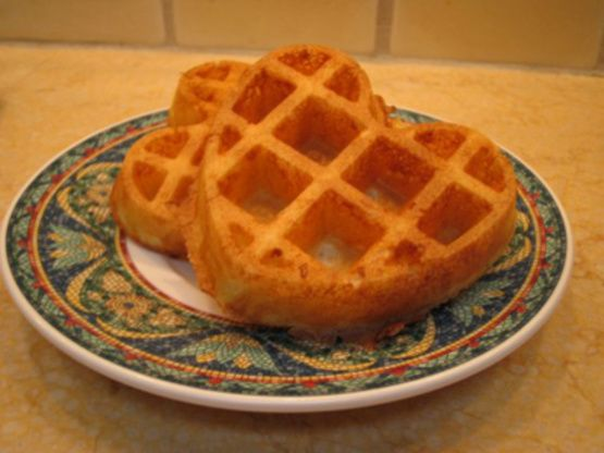 Reincarnated from the Frugal Gourmets recipe, this waffle batter is made air light by the addition of a beaten egg white to produce an exceptionally crisp waffle.  Best made on an older waffle iron, the teflon ones can undercook your waffles.  You may need to let it continue to cook for 30 seconds even after the light goes off for a nice crunchy waffle.