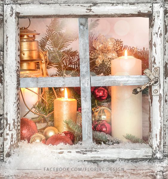 Christmas arrangement with old rural window, winter decorations and candles