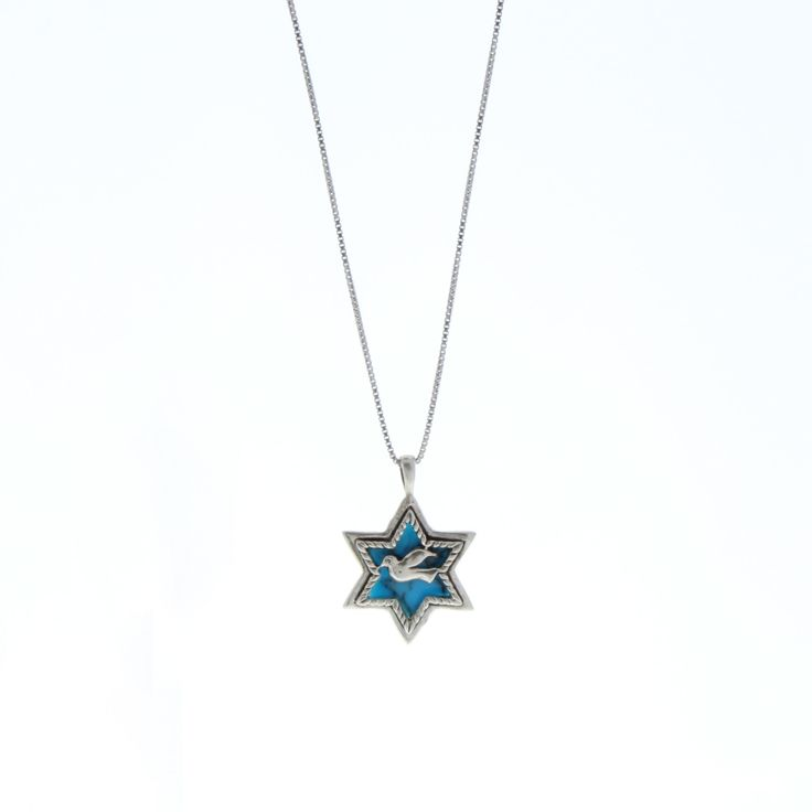 Handcrafted 925 Sterling Silver Star of David pendant necklace. A fabulous creation featuring a fine silver chain, adorned with a magnificent Star of David showcasing an exquisite star-shaped manmade Turquoise set in a fine silver setting and a smaller silver dove of peace. This gorgeous pendant necklace is perfect to add refreshing colors and a hint of tradition to your look.