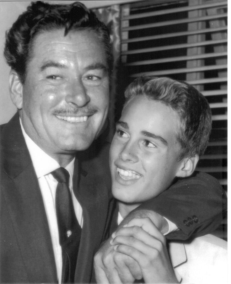 Errol Flynn and son Sean /// While he may have been a young man by our standards, Flynn begins appearing sodden in photos of him around 50, or so. Still so young, yet in the bag by then, it would appear, and it seems true of other major male stars who hit 50 in the 60s... AC