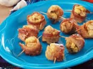 Bacon wrapped stuffing.  What's not to love?   Can also be baked in oven on a rack on foil lined pan.