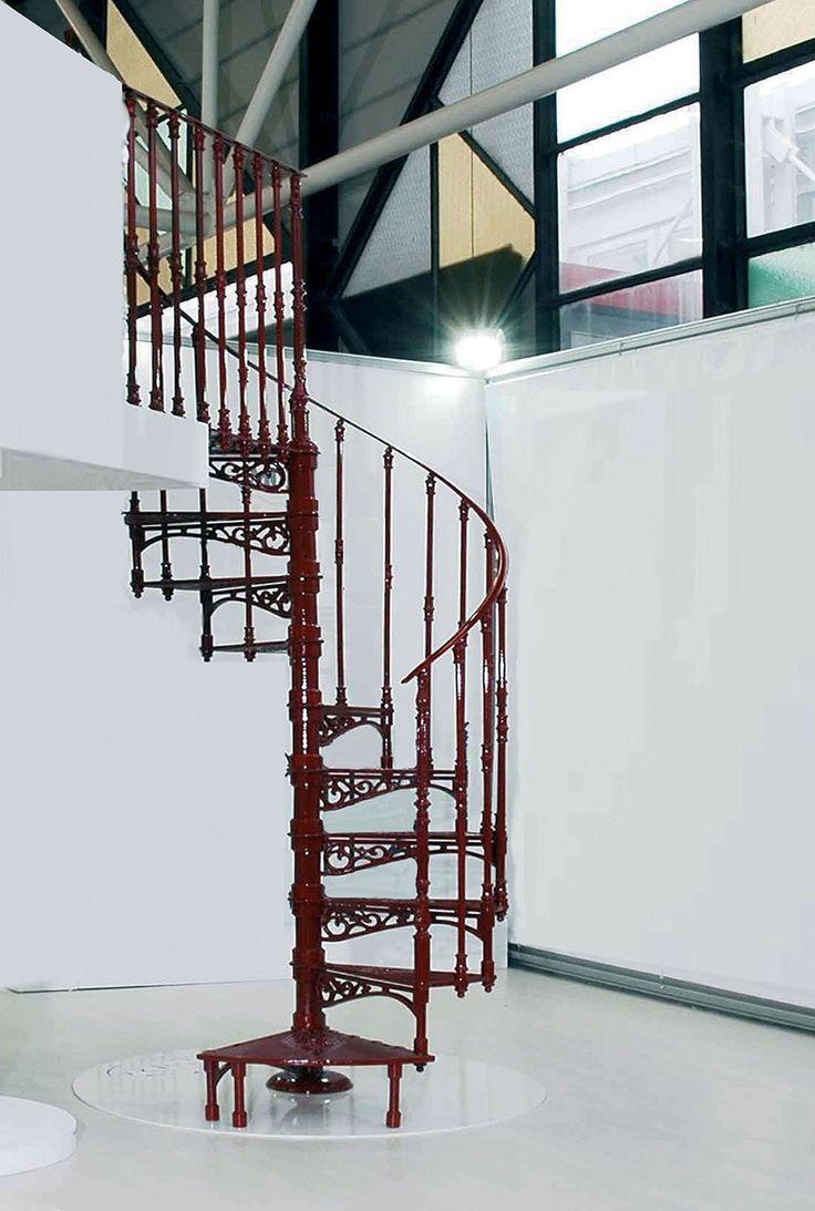 Cast-iron spiral staircases – 2050 E Ø 140 cm – RAL 3004 – Balusters with floral ornament. http://www.modus.sm/en/products/spiral-staircases/stair-color/ral-3004/ral3004.asp?ID0=1291&ID0_=1291&ID1=1314&ID1_=1314&ID2=2290&ID2_=2290&ID3=2401&ID3_=2401&IDProdotto=2901&L=EN #Modus #ModusStaircase #indoorfurniture #inspiration #castiron #staircase #spiralstaircase #ghisa #color #red #redcastiron #railing #scaleachiocciola #floralornament #tread #design #interiordesign #architecture #follow