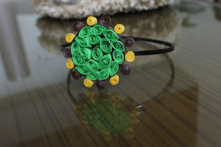 Paper quilling hair accessory.