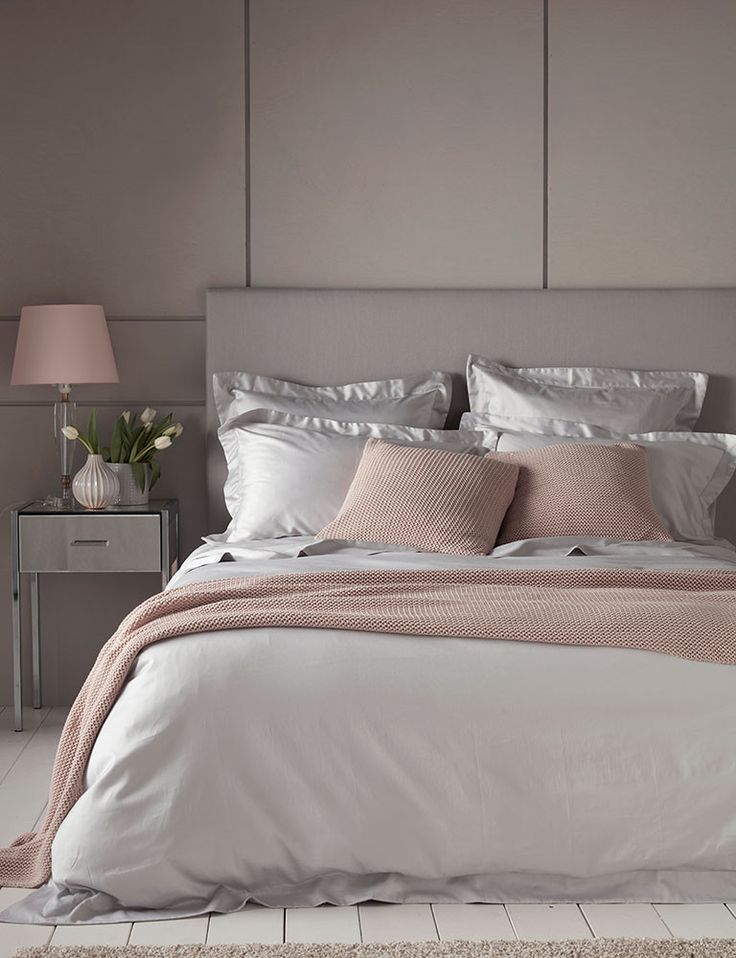 Luxury Silver bedding for superior slumber. A contemporary and classic  bedroom interior. Mixing light