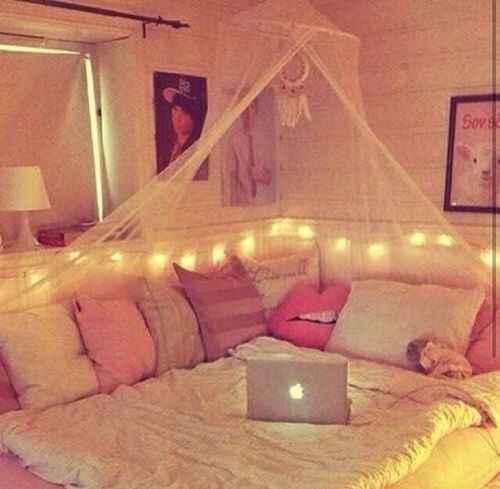 love all the pillows, lights, and canopy